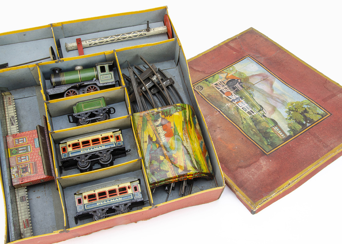 An uncommon boxed German-made 0 Gauge clockwork Train Set for the British Market, the box lid