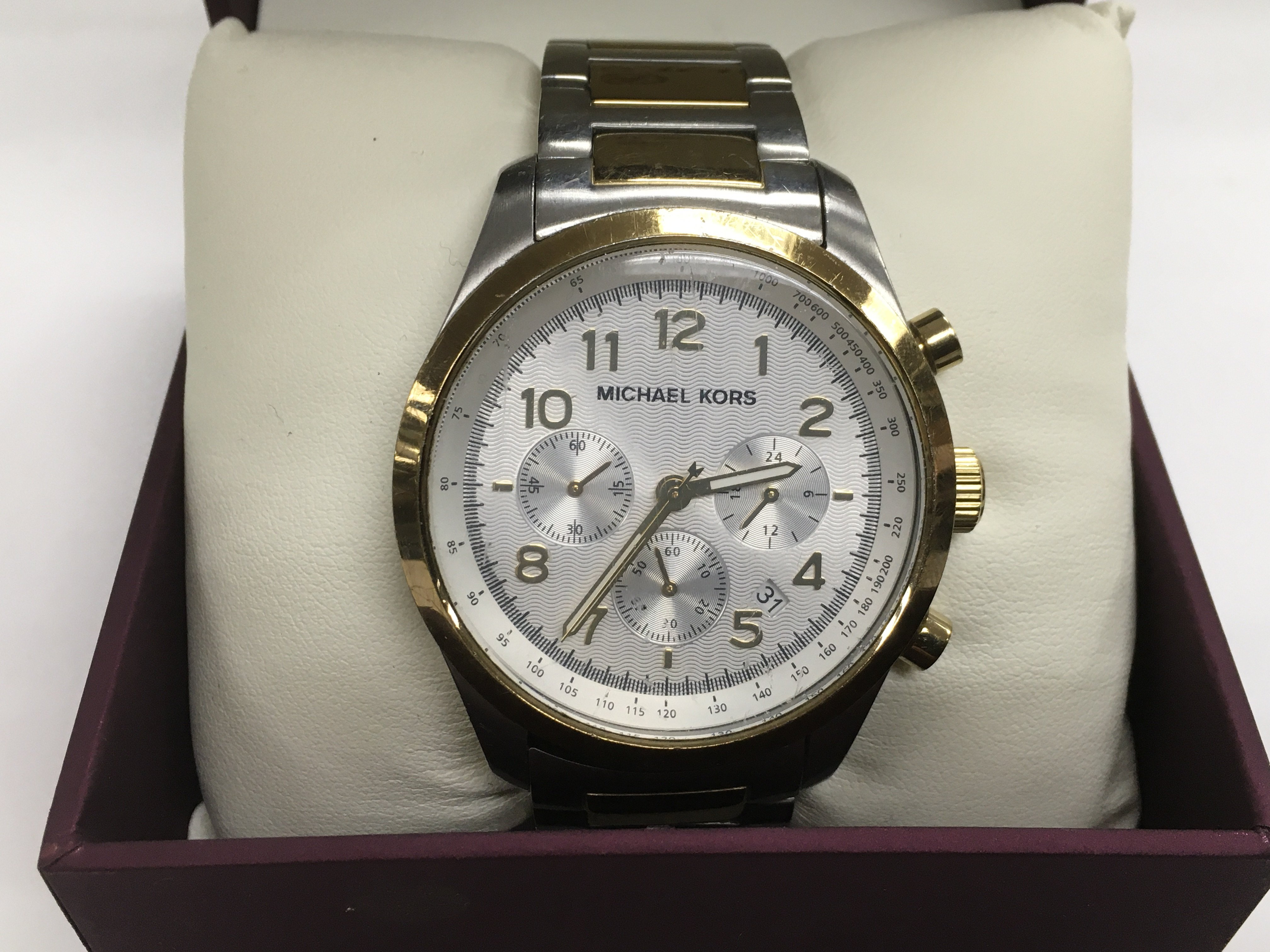 Lot 53 - A gents Michael Kors chronograph watch with champa