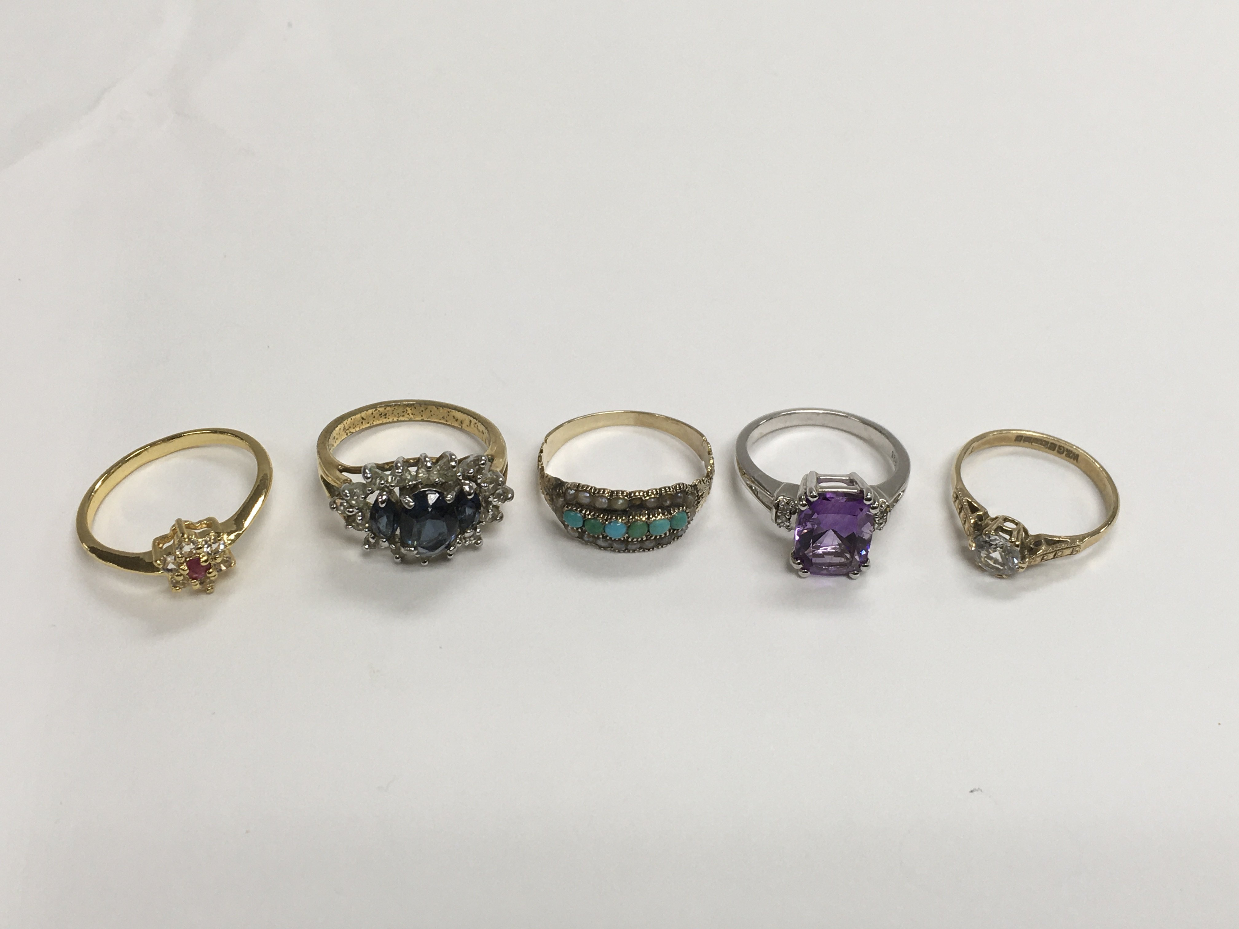 Lot 26 - A collection of gold and costume jewellery rings.