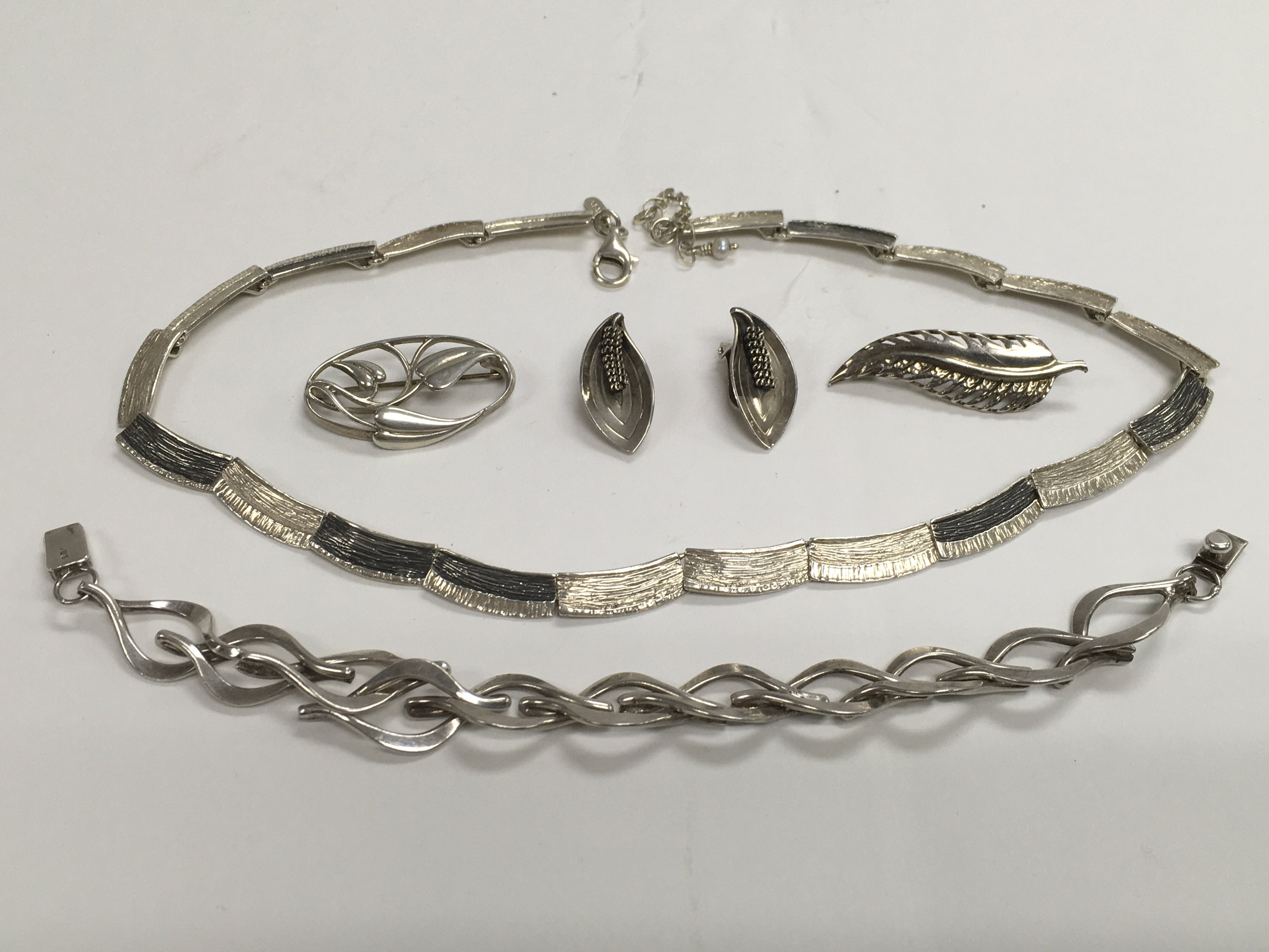 Lot 21 - A collection of Scandinavian and other silver jewe
