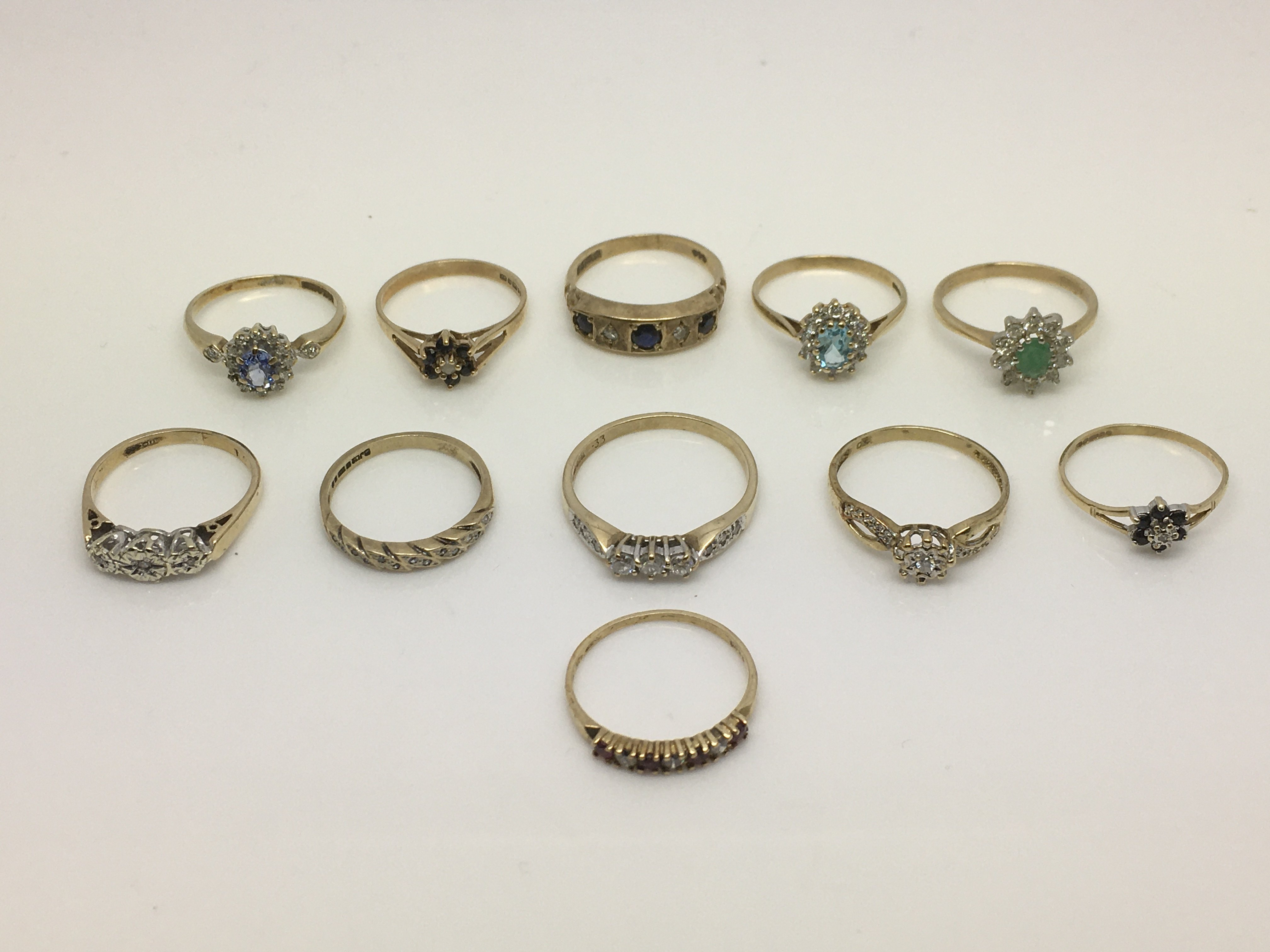 Lot 7 - A collection of 9ct gold rings set with diamonds a