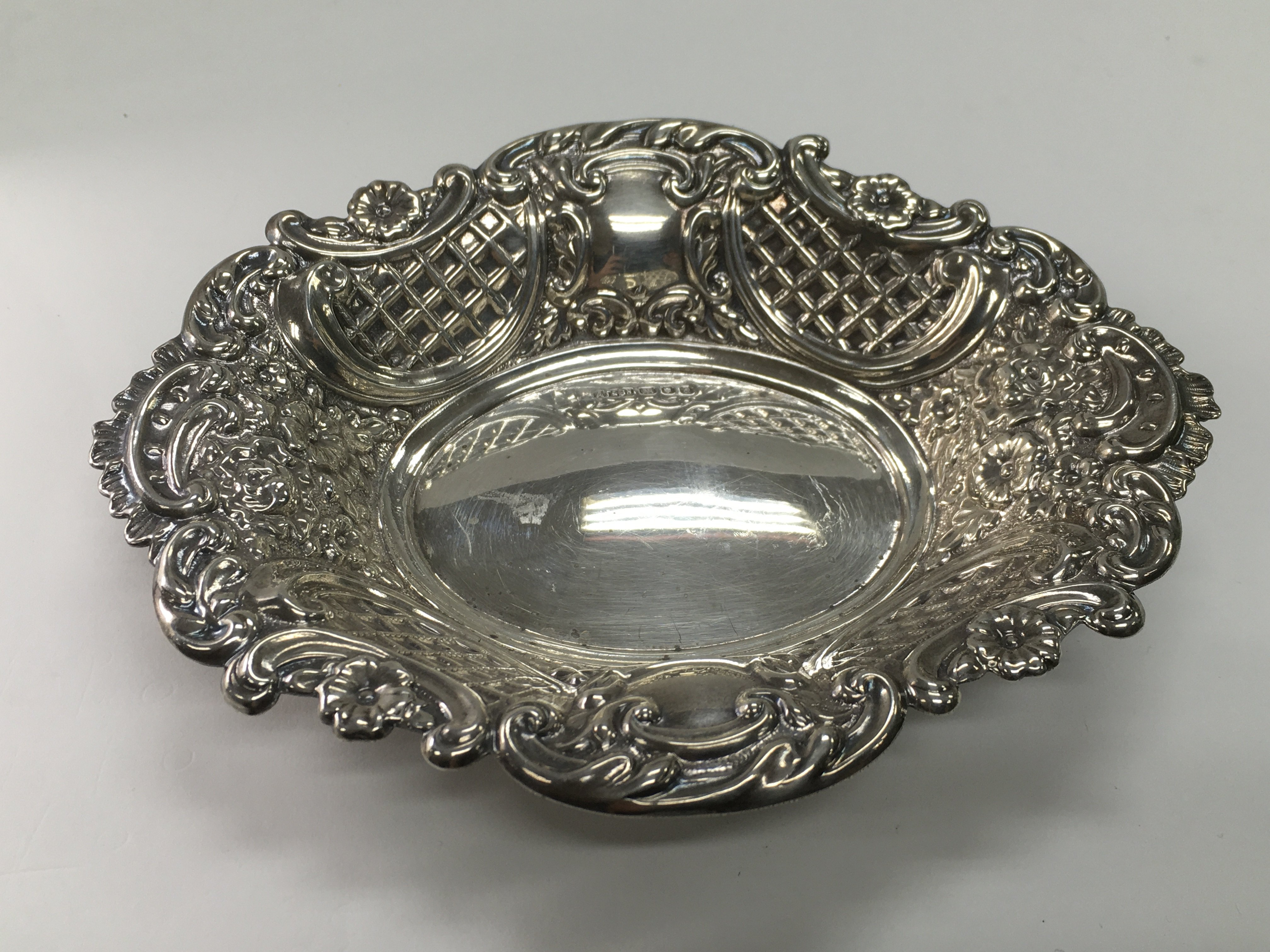 Lot 30 - A silver dish with repousse work decoration, Londo