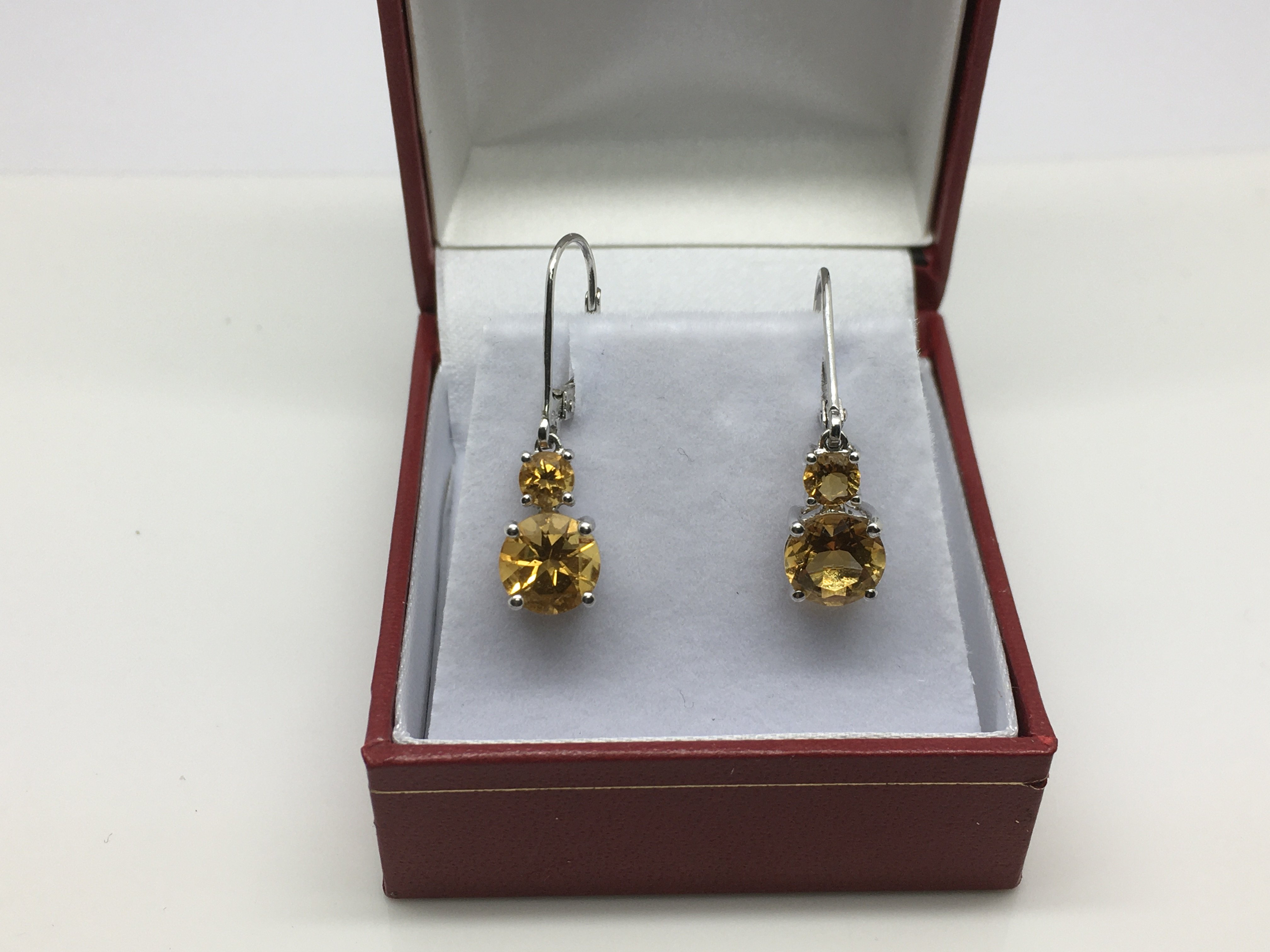 Lot 16 - A pair of 9ct white gold and citrine earrings, app