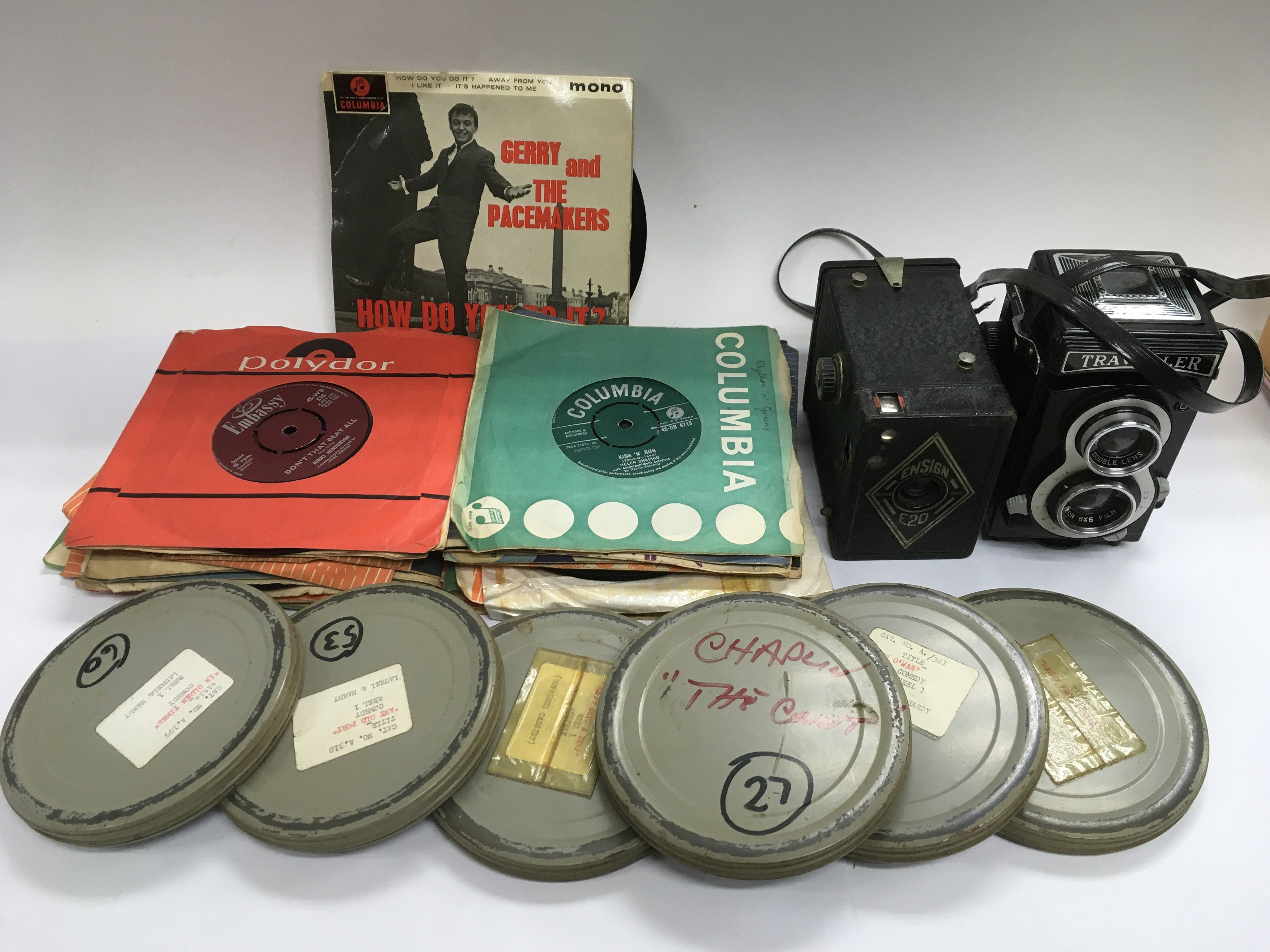 Lot 1973 - A box of oddments including 7inch singles, cameras