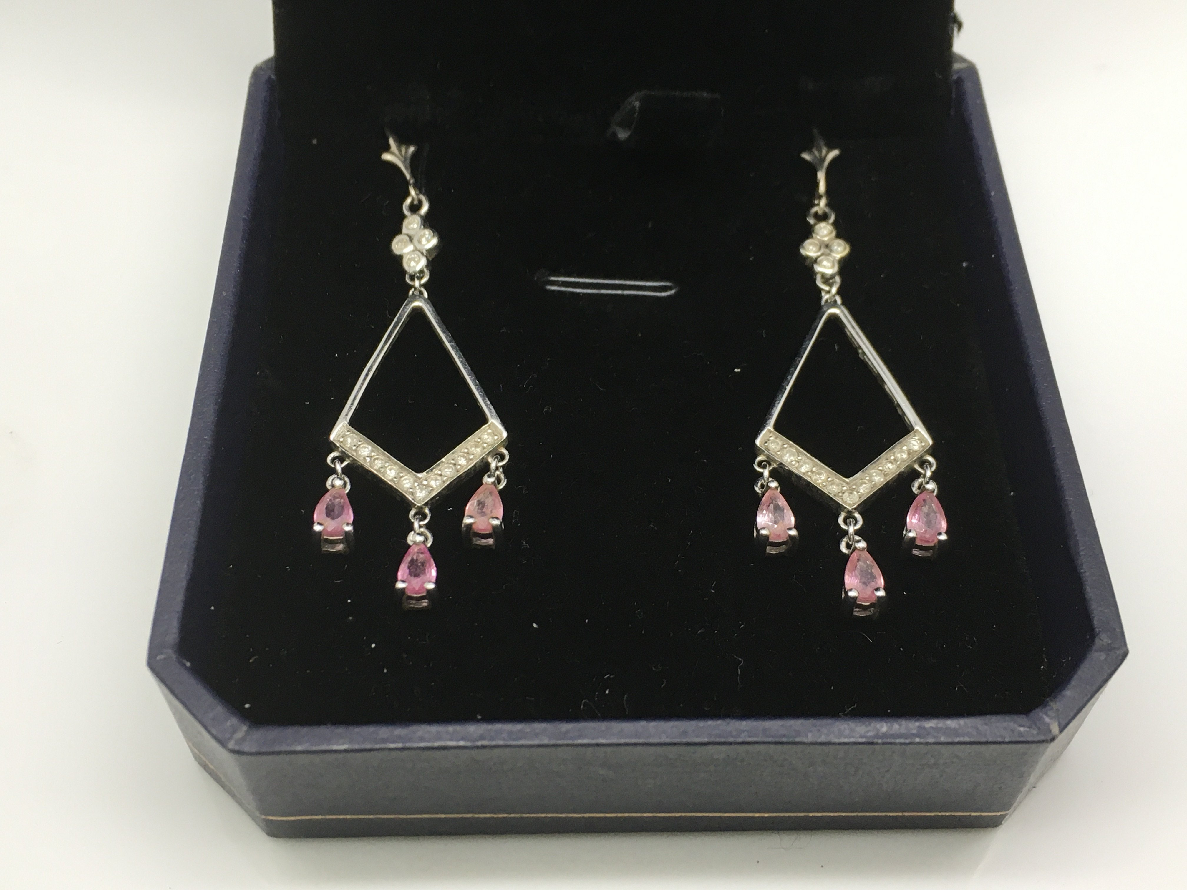 Lot 46 - A pair of white gold Art Deco style drop earrings,