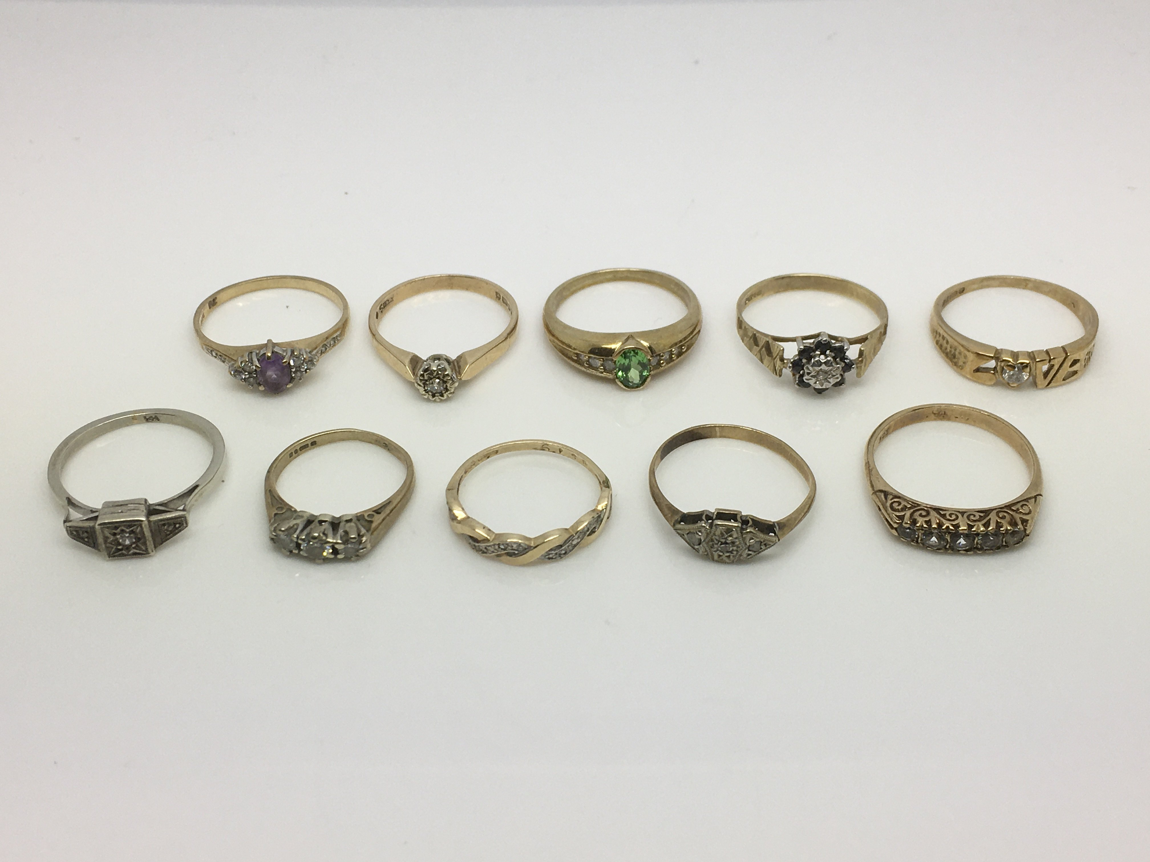 Lot 8 - A similar collection of 9ct gold rings set with di