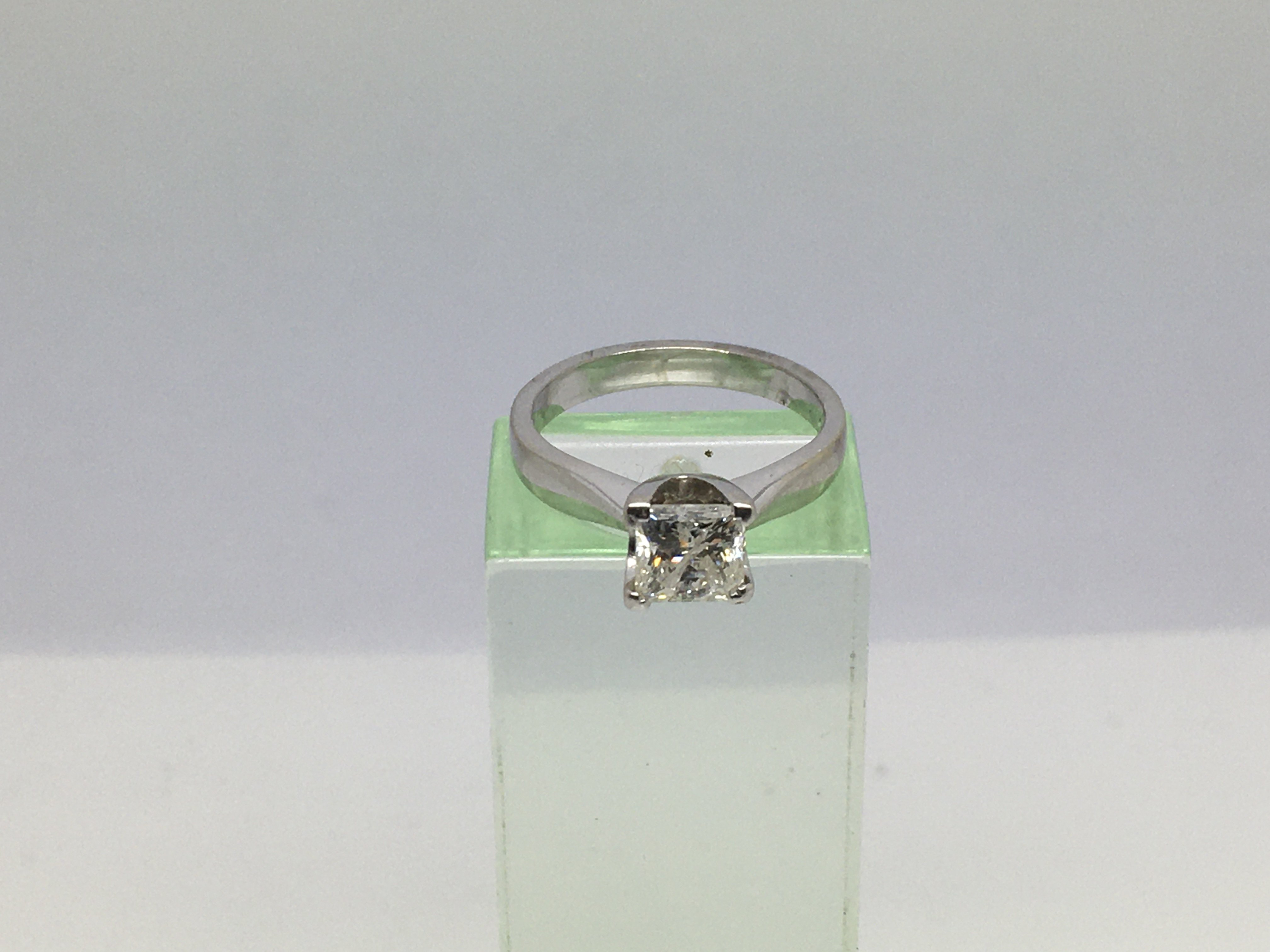 Lot 1 - An 18ct white gold ring set with a princess cut di