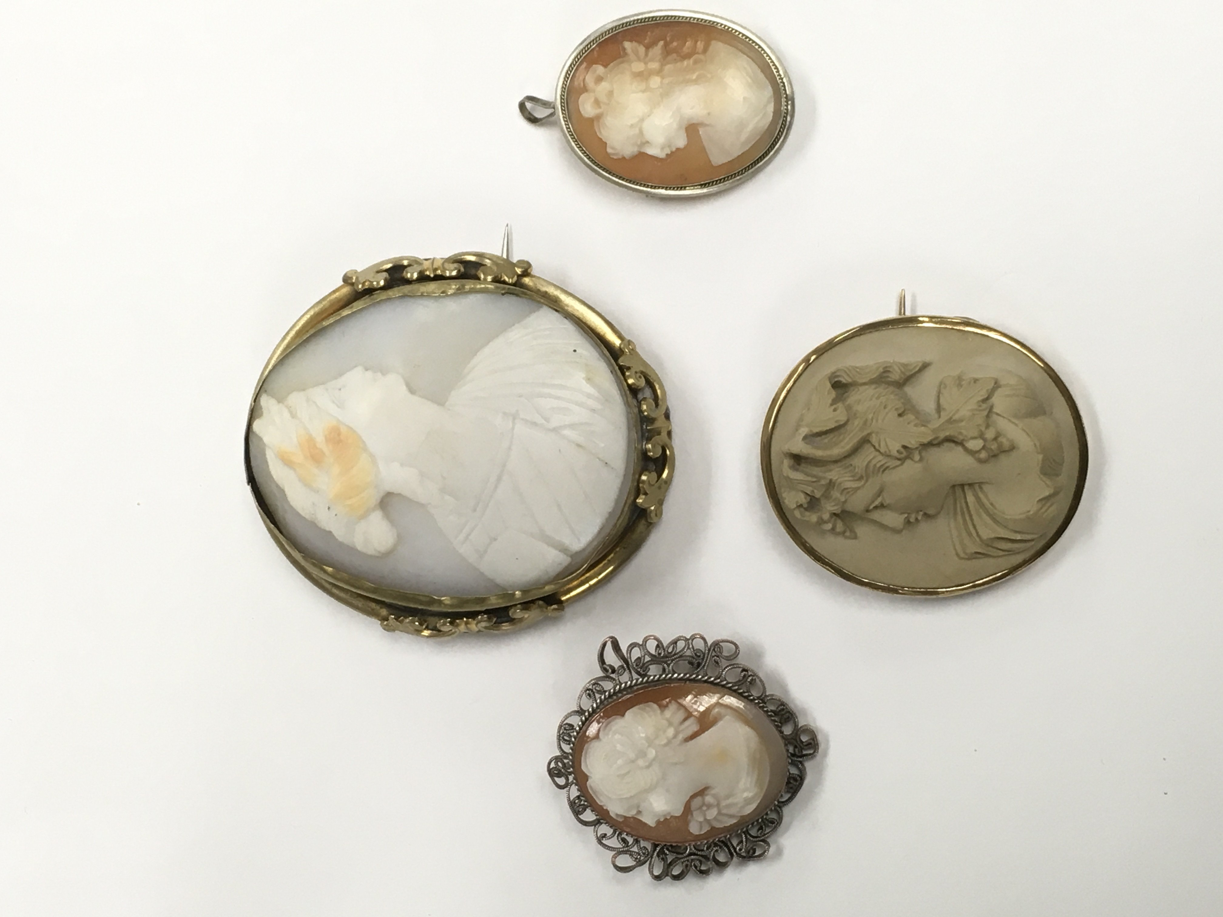 Lot 27 - Four Victorian cameo brooches.