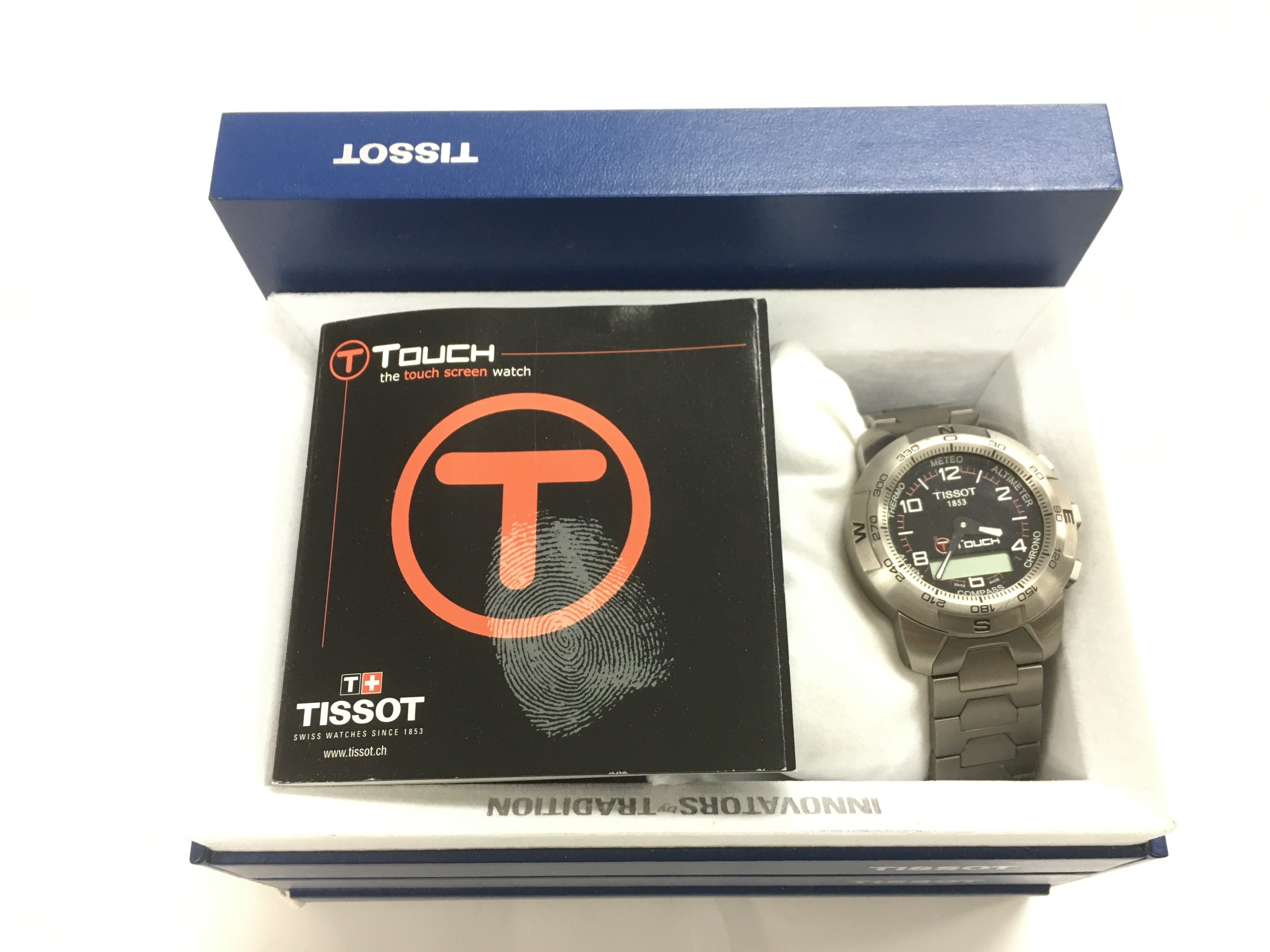 Lot 48 - A boxed Tissot Touch watch.