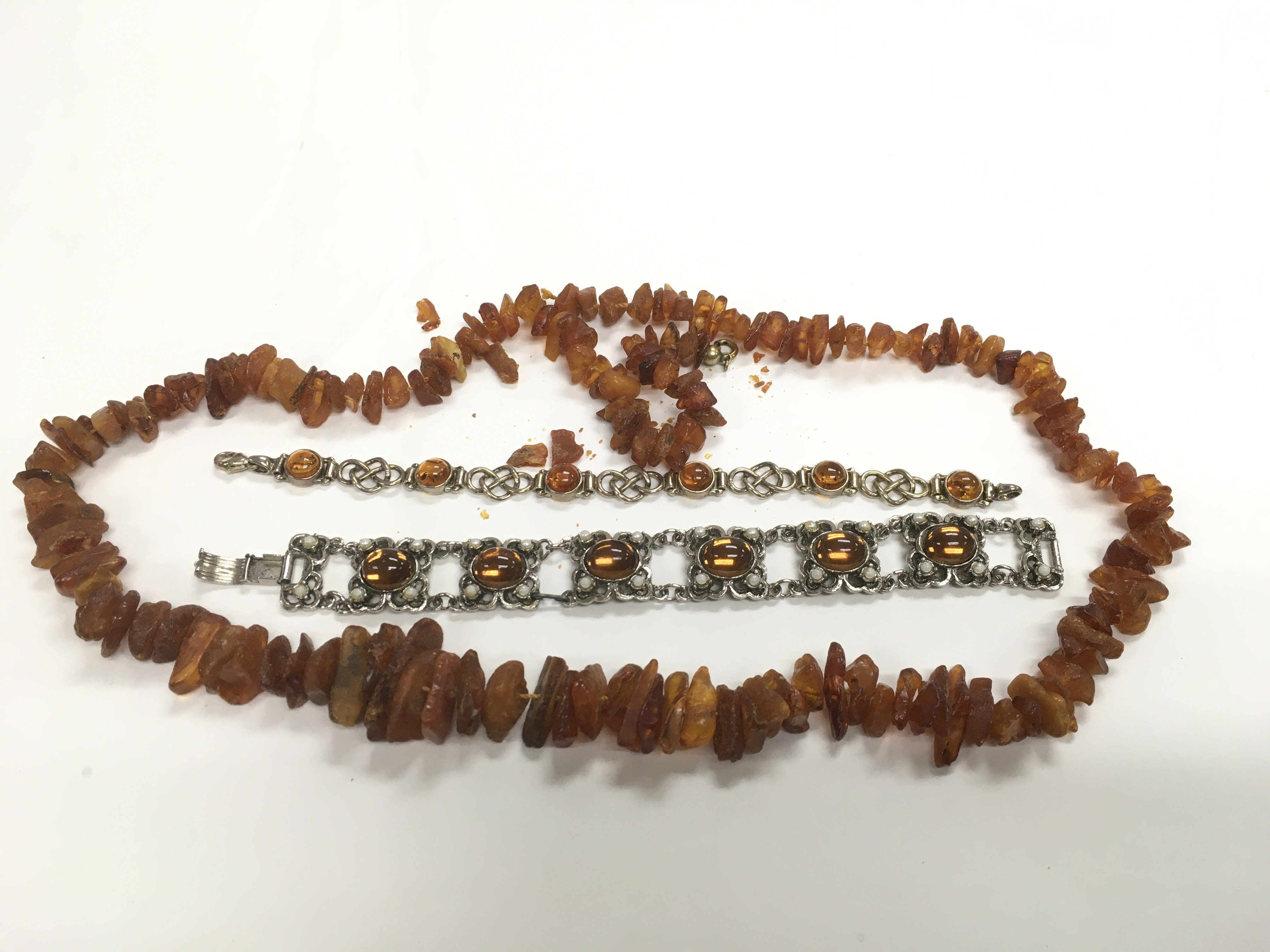 Lot 25 - An amber bracelet together with other amber type j