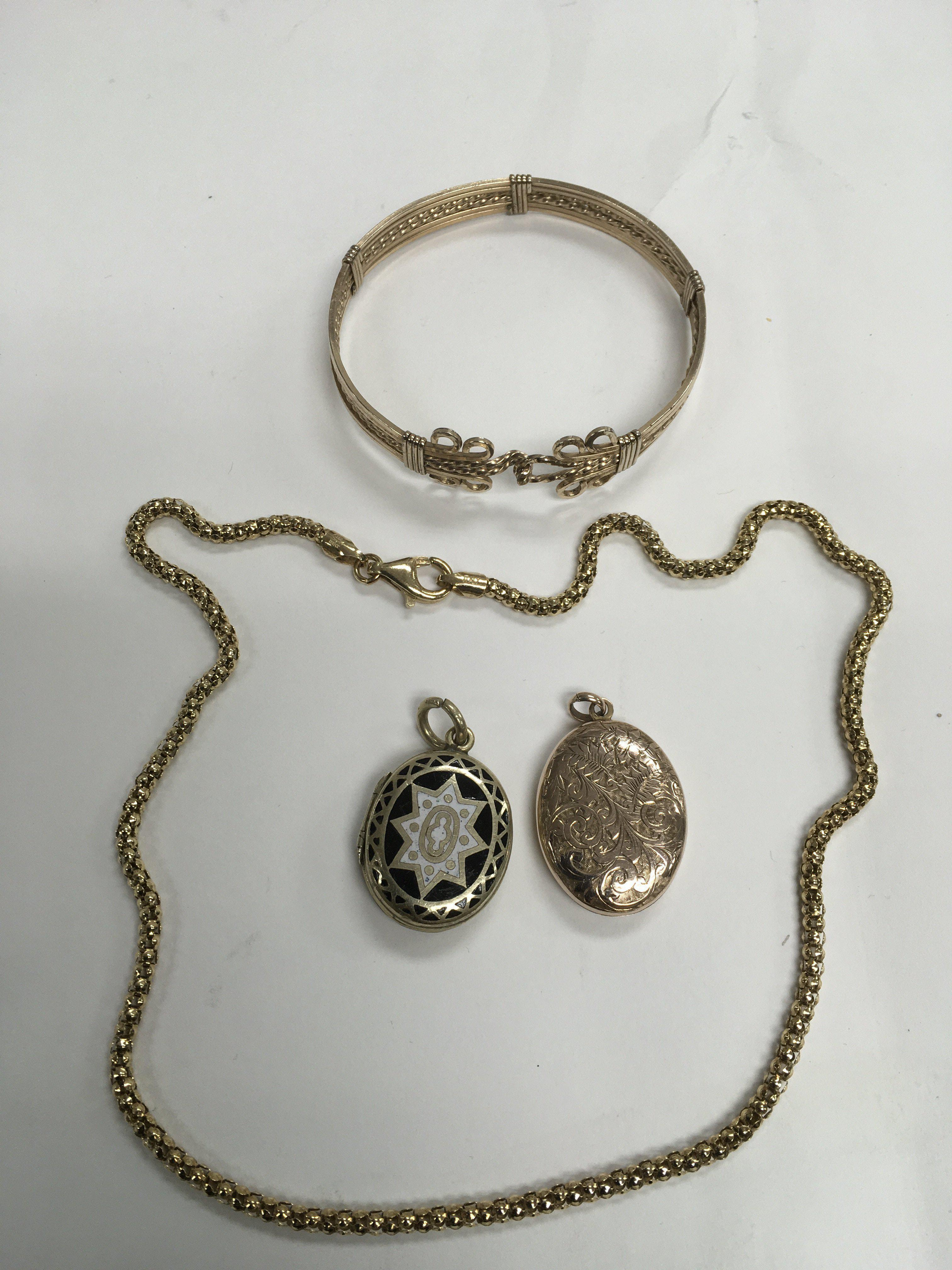 Lot 24 - Two Victorian lockets and other yellow metal jewel