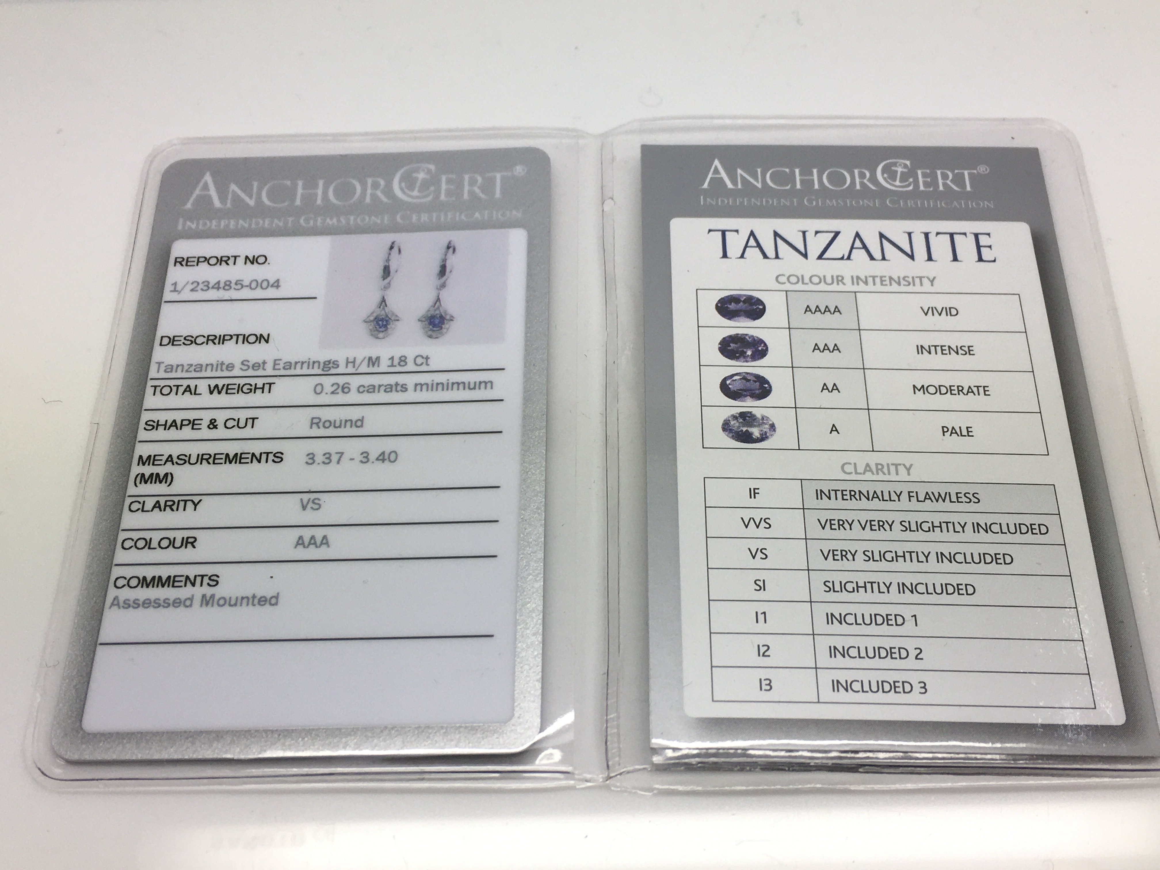 Lot 15 - A pair of 18ct white gold diamond and tanzanite ea