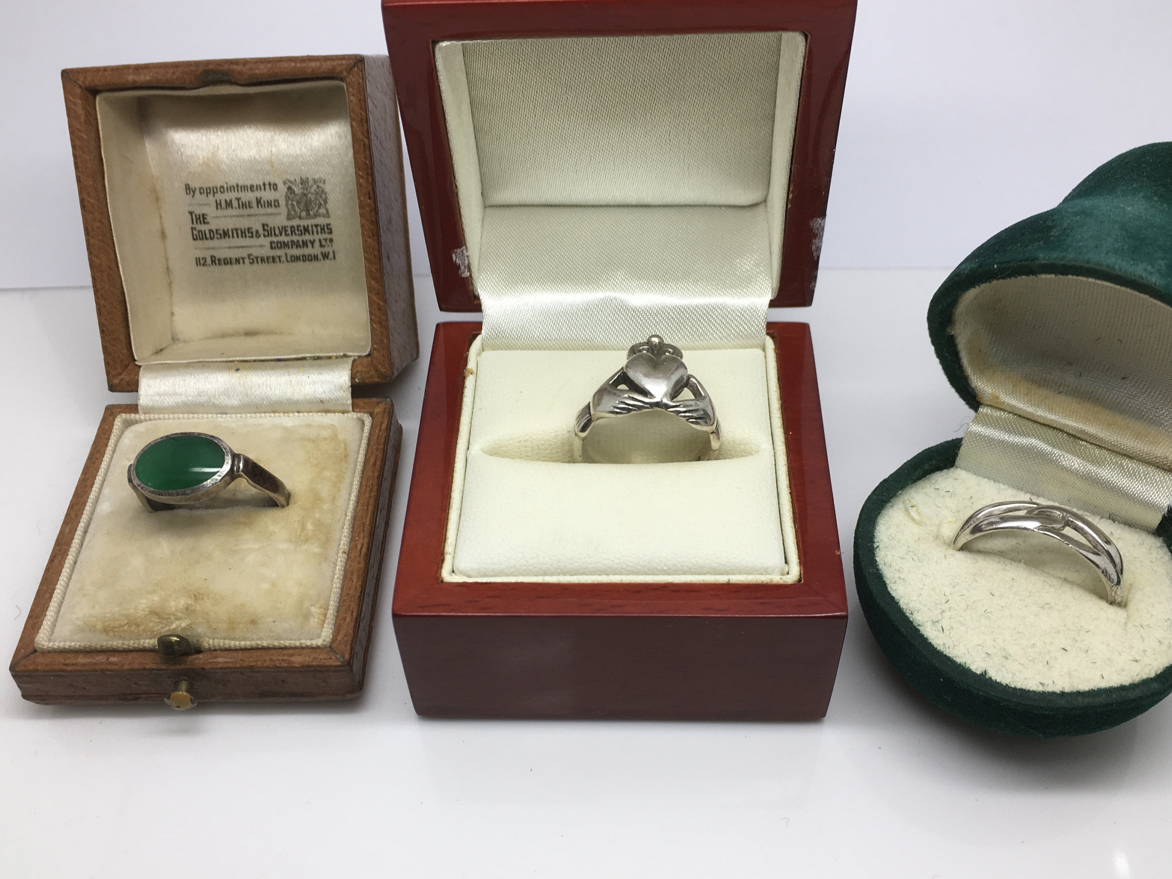 Lot 33 - Three silver rings in boxes, one with a jade type
