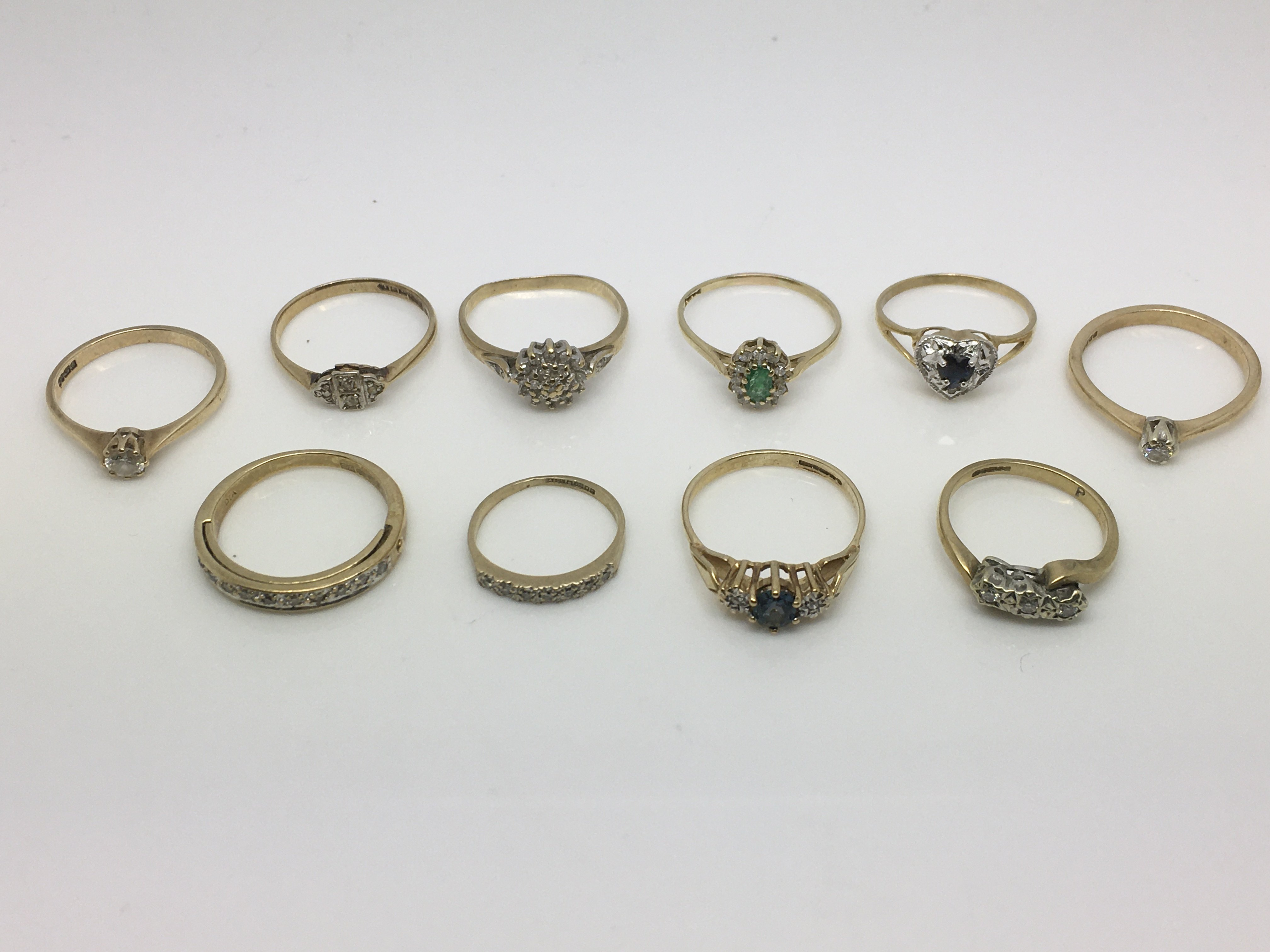 Lot 9 - Ten 9ct gold rings set with diamonds and other sto