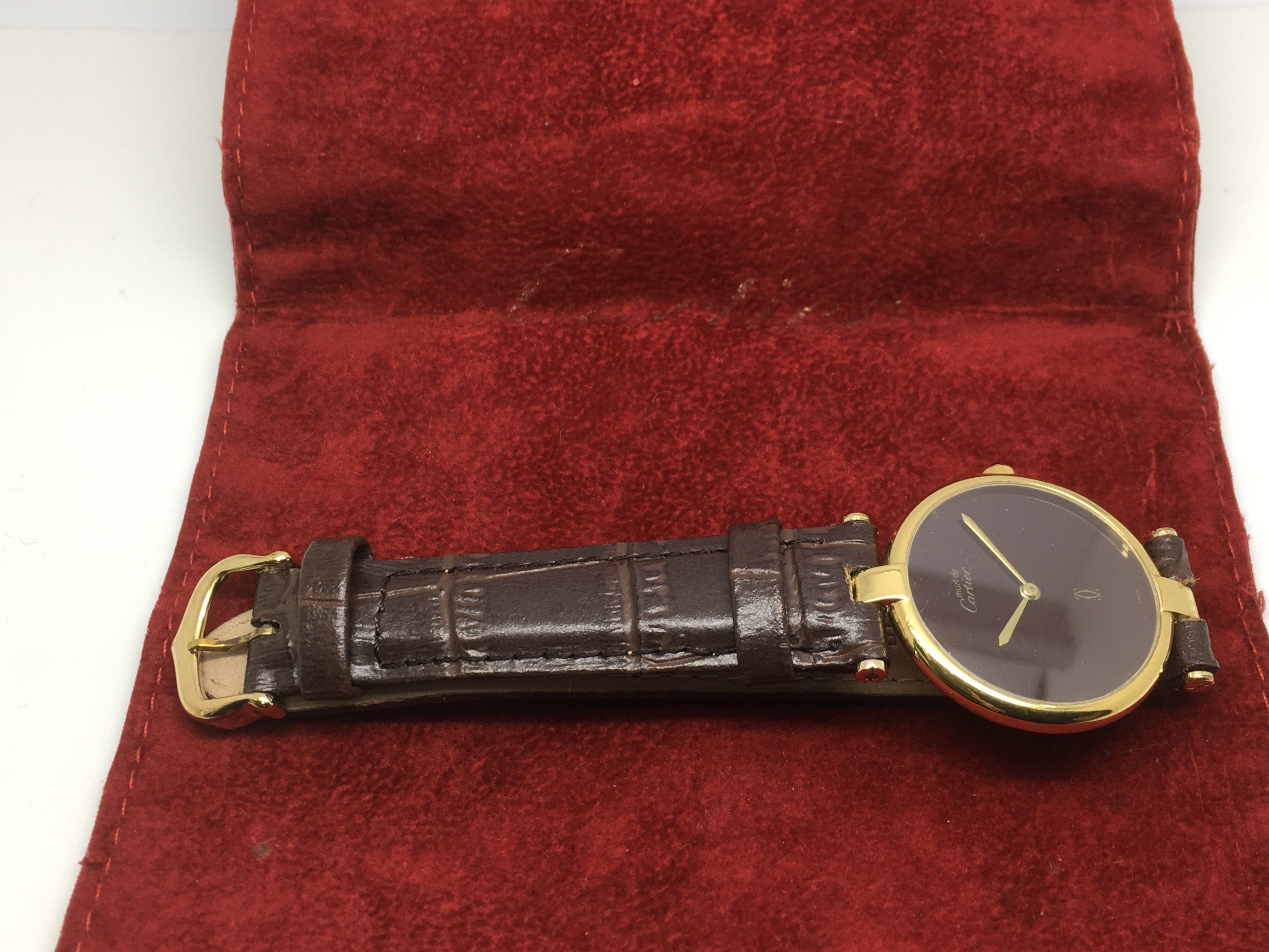 Lot 35 - A Cartier Argents watch with Cartier pouch.