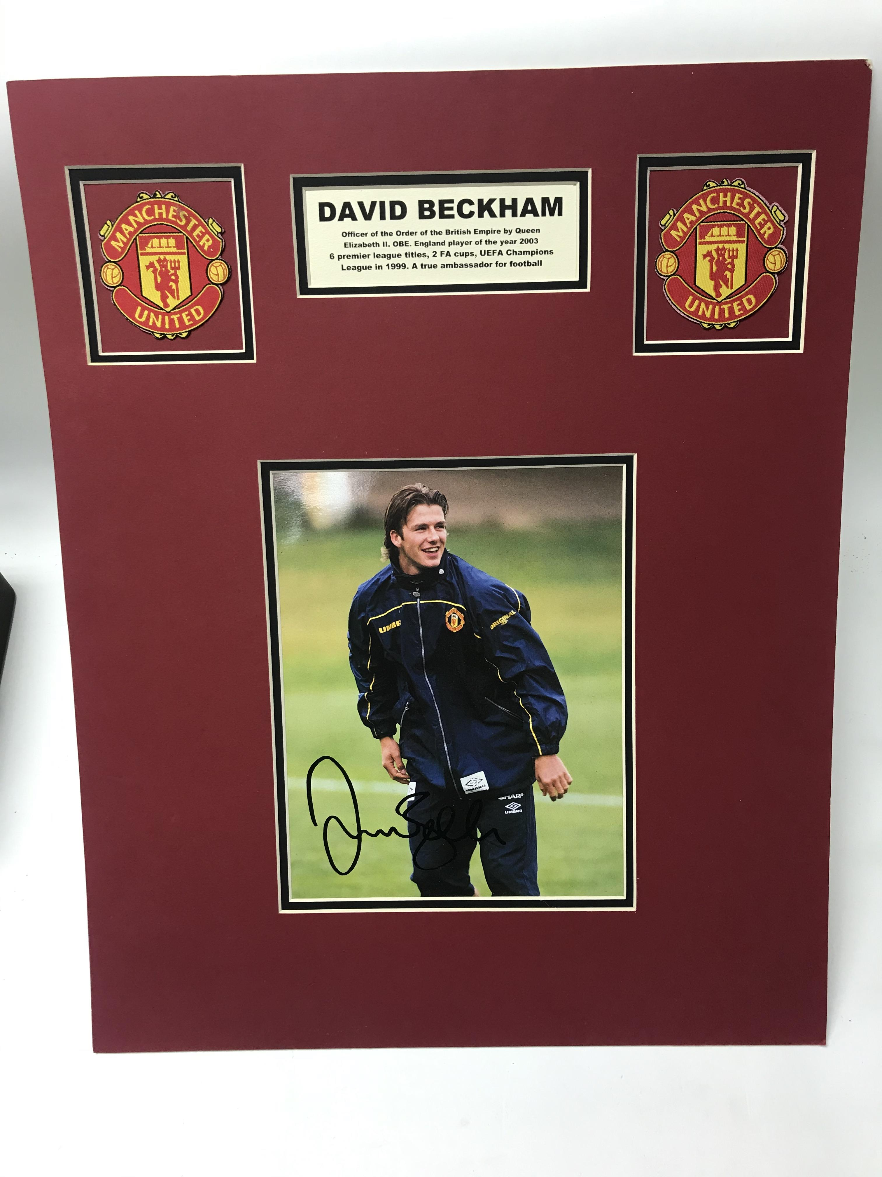 Lot 17 - An original mounted and signed David Beckham Manchester United photo