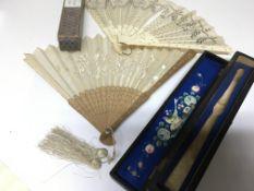 Two vintage fans including a carved sandalwood fan