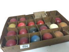 A set of eighteen antique ivory billiard balls.