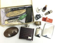 A box of various interesting items including a hip