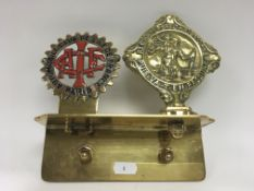 A French badge and St Christopher badge mounted on