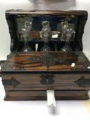 A Victorian tantalus with mirrored back and three