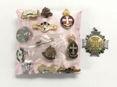 A collection of badges including Boy Scouts, Girls