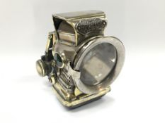 A Petroleum Silver King bicycle lamp by Joseph Luc