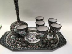 A Indian enamel tray with six matching cups and va