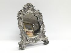 An ornate Victorian style mirror decorated with ch