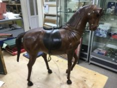 A vintage large leather horse, approx height 65cm.