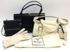 A vintage black patent leather hand bag, a small b