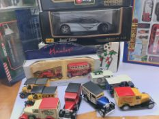 A collection of boxed and loose cars.