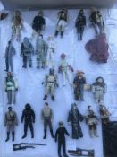 A collection of lose figures including Star Wars,