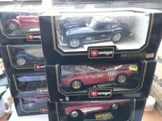A collection of Burago boxed cars.(8)