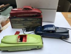 3 tin plate cars, one boxed and one spring driven.