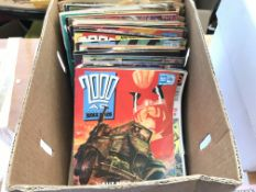 A box containing a collection of 200 ad comics