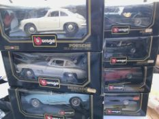 A collection of Burago boxed cars. (8)