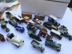 A collection of various toy cars and two boxed Mat