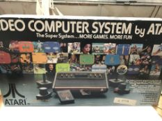An Atari video games system boxed. Model number Cx