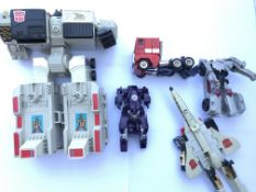 A collection of Transformers figures.