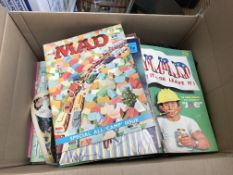 A box containing a collection of mad comics.