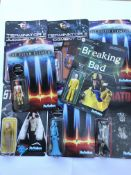 A collection of movie action figures, all carded (