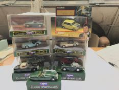 A collection of classic Corgi diecast cars.