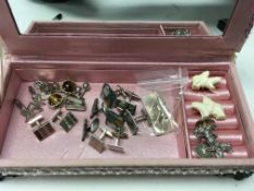 12 pairs of cuff links including silver examples.