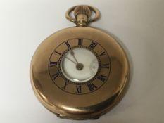 A 9carat gold half hunter button wind pocket watch