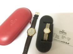 A Ladies stainless steel and gold tone Omega wrist