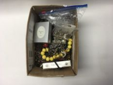 A box of costume jewellery including some new item