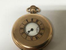 A gold plated half hunter button wind pocket watch