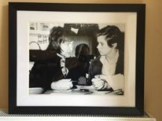 George Best Signed Framed Photo: Depicting George in conversation with a girl. Black and white