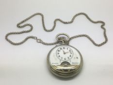 A silver cased pocket watch with visible dial.